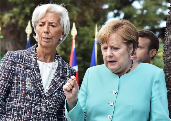 Christine Lagarde and German Chancellor Angela Merkel (R)