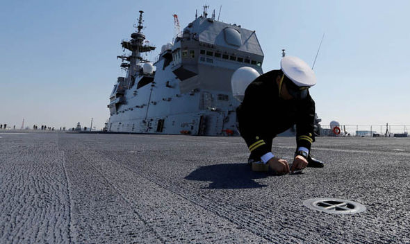 Person kneeling in front of carrier