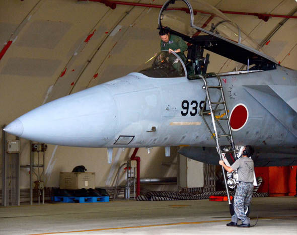 Japanese fighter jet pilot prepares for action