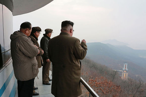 Kim Jong-un watches a rocket engine test launch