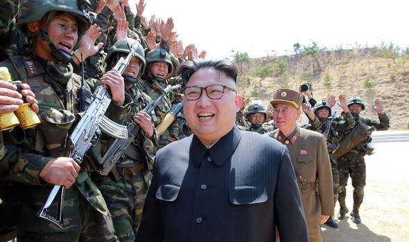 Kim Jong-Un giggles at military show