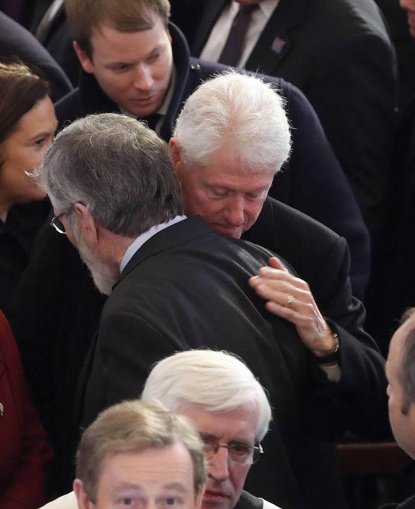 Bill Clinton hugs Gerry Adams at the funeral