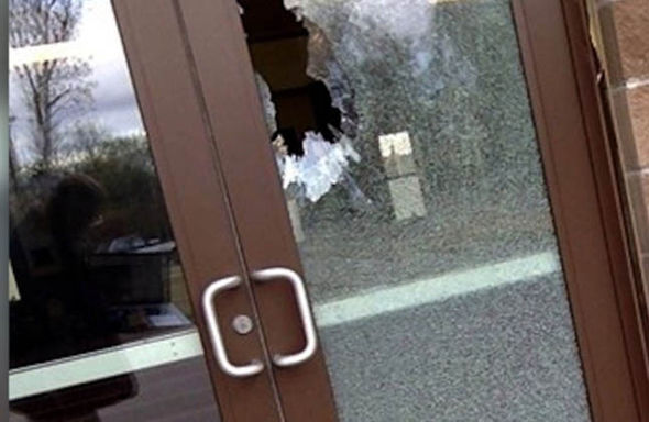 The window of the Islamic centre is smashed