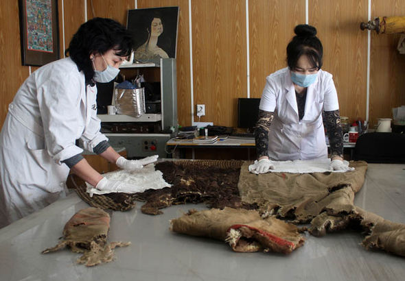 Scientists with the mummy