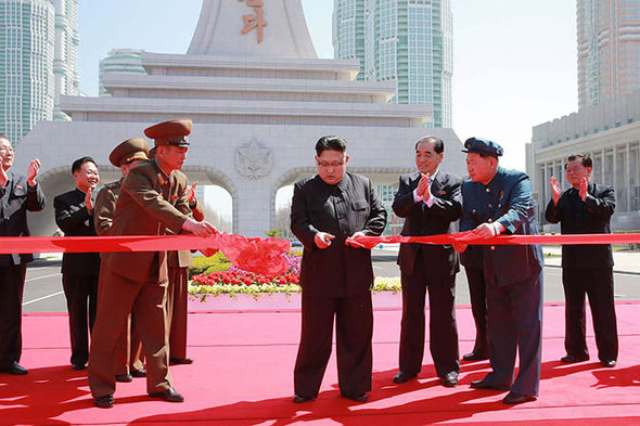 Kim Jong cutting a ribbon in Pyongyang