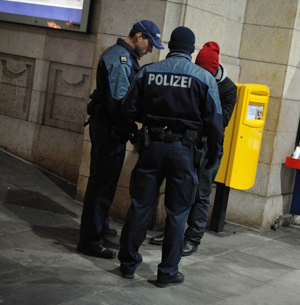 Police stop a man at Basel tain station