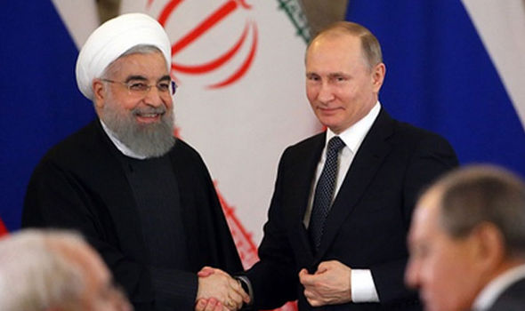 Iran's Hassan Rouhani and Vladimir Putin of Russia in March