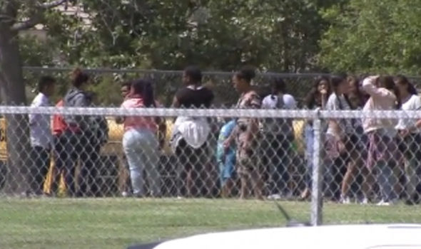 Police are moving students out of the school as worried parents wait outside