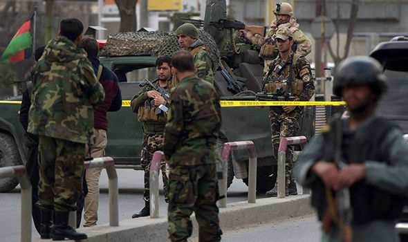 Security forces can be seen blocking roads around the hospital