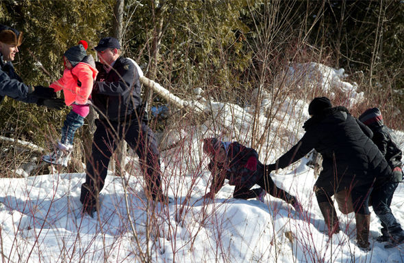 The family struggle up the snowy gully to seek asylum in Canada