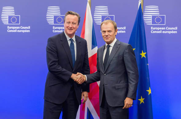 European Council President Donald Tusk, right, welcomes British Prime Minister David Cameron upon his arrival at the EU Council building in Brussels