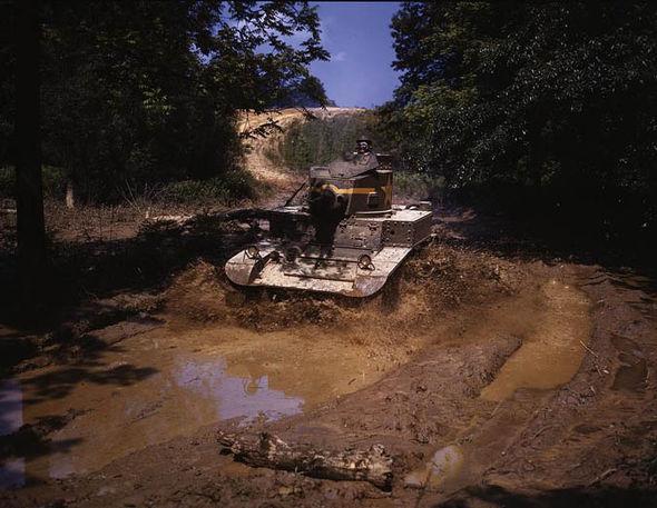 A tank driving through the mud
