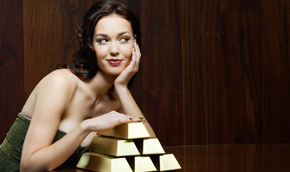 Woman poses with gold bars