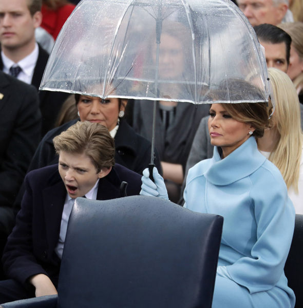 Barron Trump yawns during his father's first speech as president