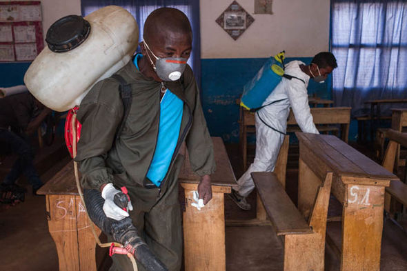 Black Death: A man disinfecting a school