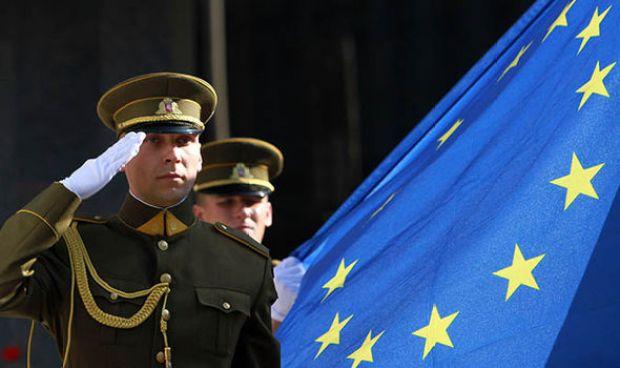 Troops salute the EU flag