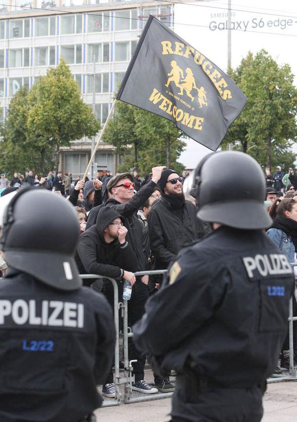 Left-wing German protestors welcome refugees