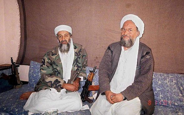 sama bin Laden (L) sitting with his deputy Ayman al-Zawahiri