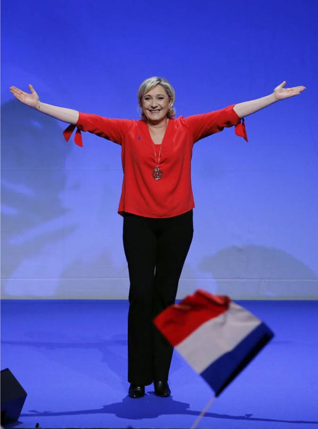 Marine Le Pen with arms outstretched