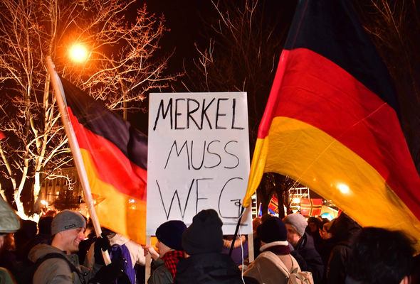 Crowds wave German flags as they call for Angela Merkel to step down