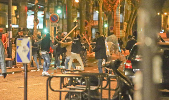 Migrants brawl on the streets of Paris