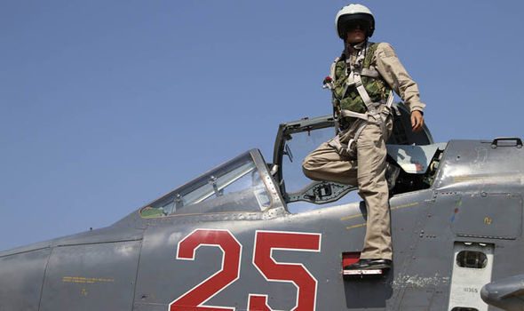 A Russian fighter pilot climbs down from his jet in Syria