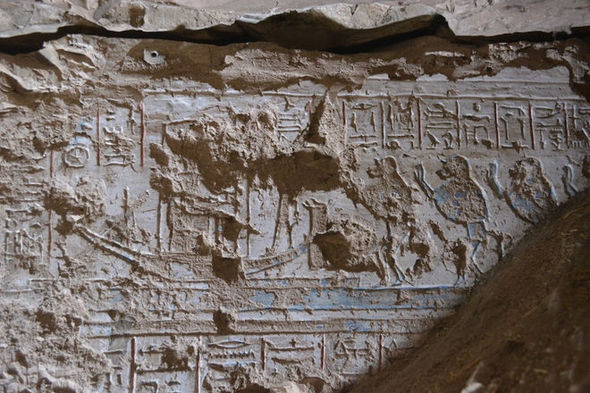 Carving of Ra-Atum's boat worshipped by baboons
