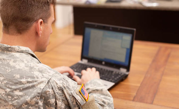 soldier using laptop