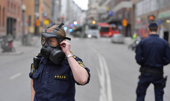 Stockholm: Armed police are on the scene with gas masks