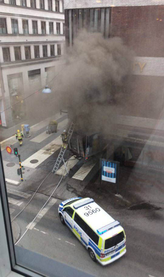 Smoke billows from department store after attack