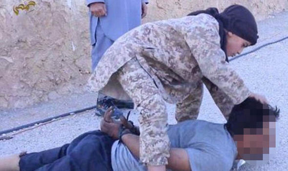 A child of about eight was filmed killing a man in Syria
