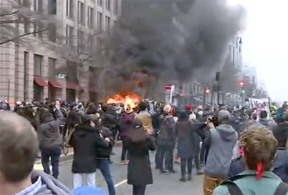 Protestors set fire to a car in Washington