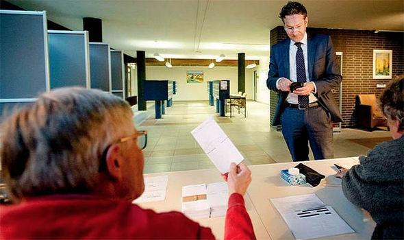 A man votes