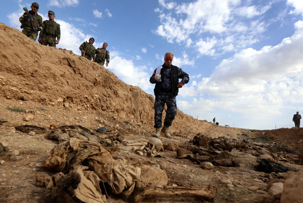 Remains of members of the Yazidi minority killed by ISIS in February