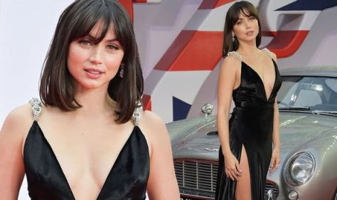 Bond girl Ana de Armas stuns in low-cut gown at No Time To Die premiere with Daniel Craig