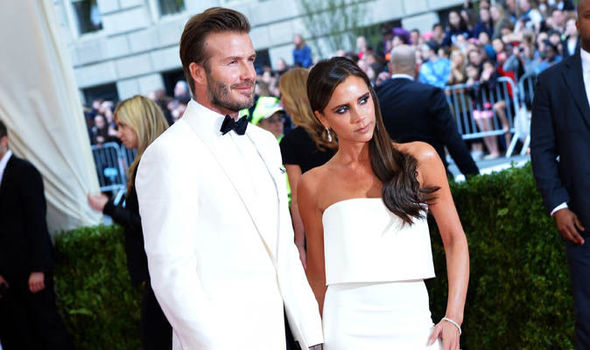 Victoria and David Beckham in white clothes