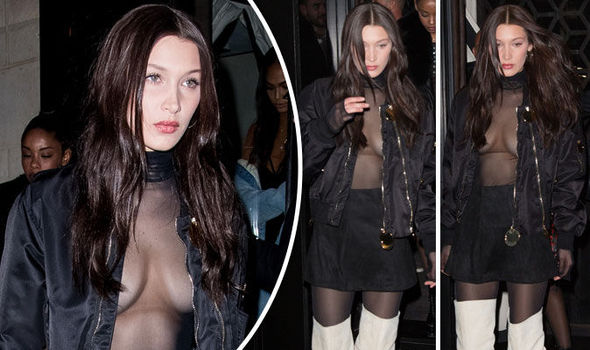 Bella Hadid went braless for a night out in Paris yesterday