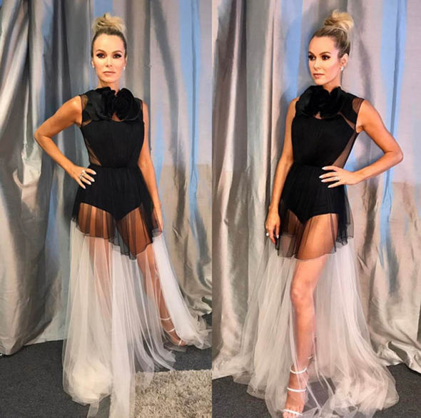 Amanda Holden shows off her endless legs in the black number