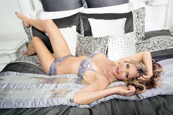 Caprice was sprawled over a bed