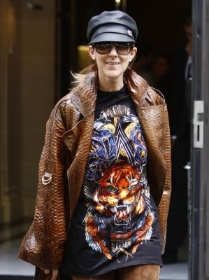 Celine Dion in brown coat