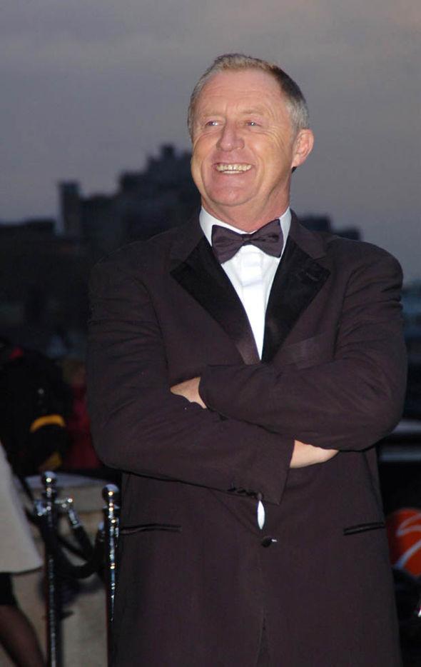 Chris Tarrant with folded arms