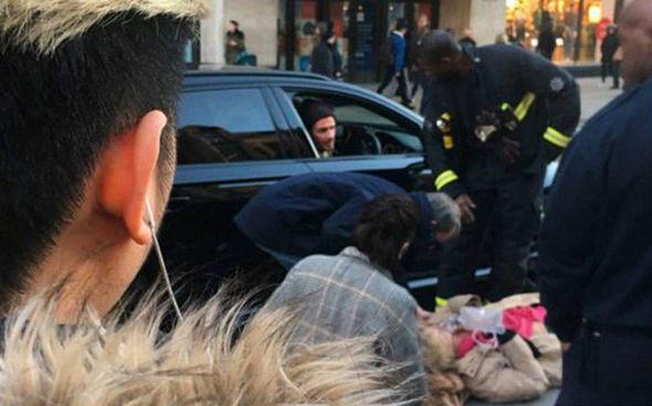 David Beckham helps elderly woman collapsed