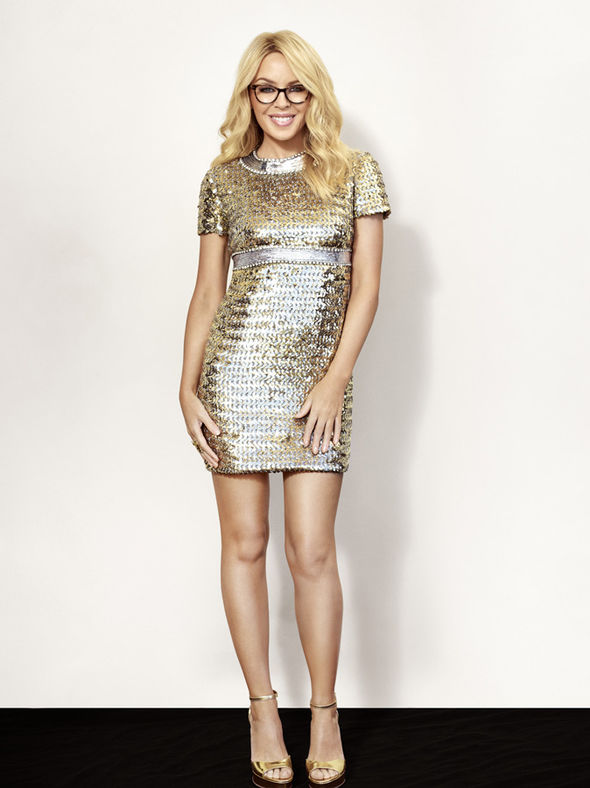 Kylie Minogue in mini silver dress