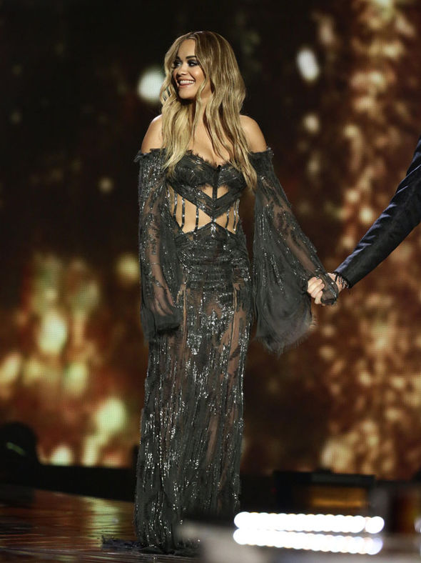 Rita flashes the flesh in her gown