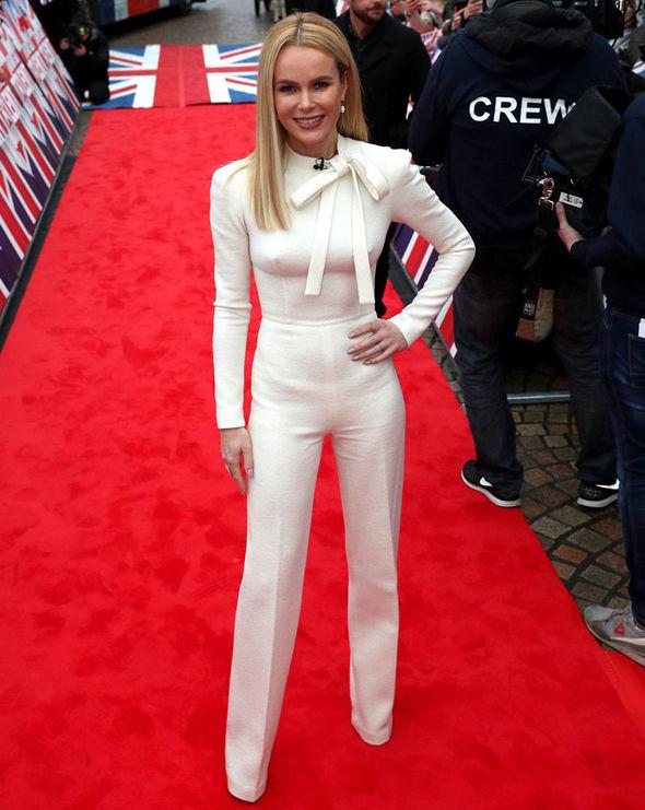 Amanda wore a white jumpsuit by Italian designer Ermanno Scervino