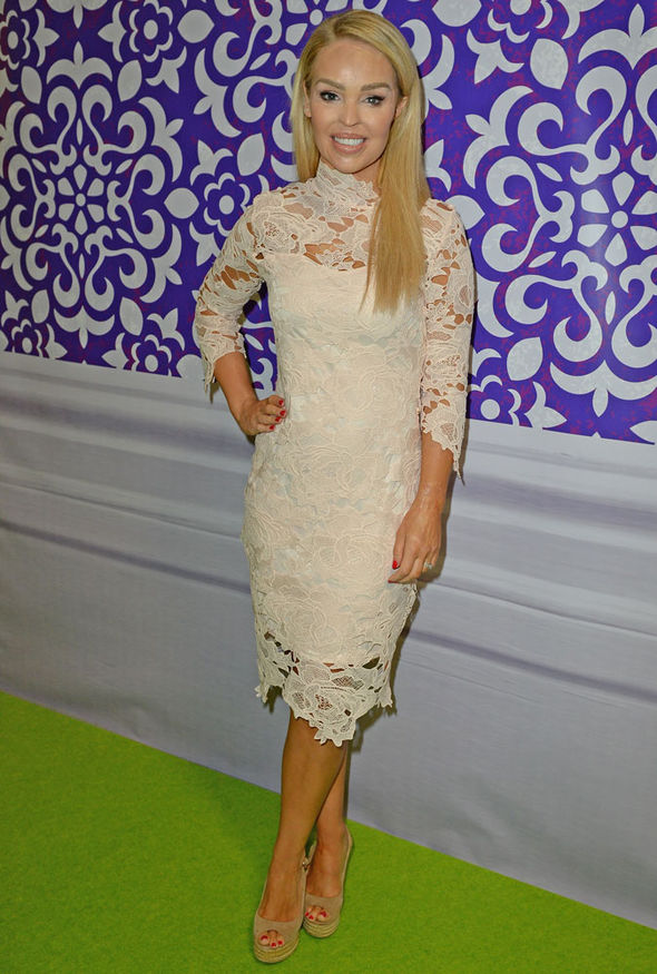 5ac82213eb2e3 Katie arrived at the Ideal Home Show wearing a cream lace dress and nude  wedges