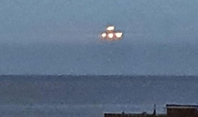 UFO spotted hovering over Devon seafront for 10 seconds before vanishing - pictures
