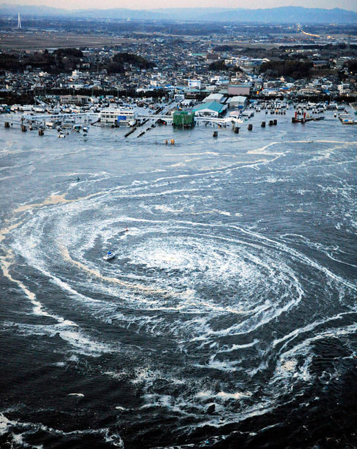 A whirlpool is seen near Oarai City, Ibaraki Prefecture, northeastern Japan, The biggest earthquake to hit Japan on record struck the northeast coast on Friday, triggering a 10-metre tsunami