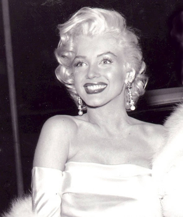 Marilyn Monroe in her signature strapless dress, gloves, fur and diamonds