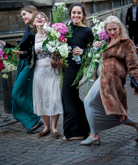 Girls leave the party with flowers